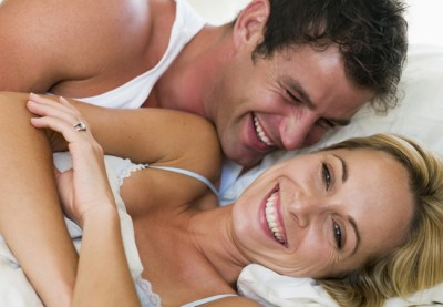 couple-laughing-hug-bed